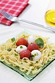 Ribbon noodles with mozzarella and tomatoes