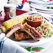 Pork rib dinner with corn and beans