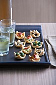 Hors d'oeuvres and glasses on tray