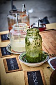 Chimichurri sauce in glass in a street kitchen