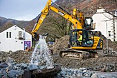 Diggers removing flood debris, UK