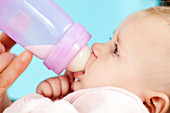 Baby with feeding bottle