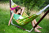 Girl lying in hammock