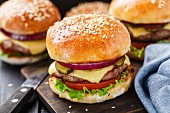 Delicious burger with beef, bacon, cheese and vegetables