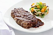 Beef steak with pepper sauce and vegetable timbale