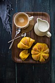 Mini pumpkin buns with coffee and a milk jug
