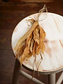 Dried wild garlic leaves on a wooden chair
