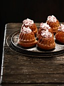 Mini gugelhupfs with raspberry cream and icing sugar