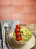 Capellini with pesto and a cherry tomato and chorizo ​​skewer
