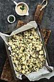 Cauliflower baked in the oven with a parsley and houmous dip