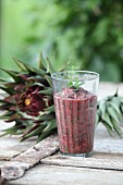A chard smoothie in a glass