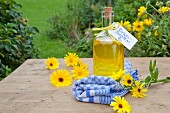 Homemade marigold oil in a bottle for gifting