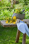Homemade medicinal oil with marigolds and St. John's wort