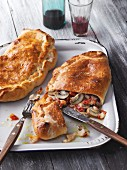 Calzone filled with mushrooms and cooked ham