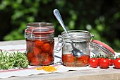 Cherry tomatoes in preserving jars