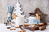 Shortbread Christmas cookies for cups, two cups of hot tea and sugar powder over table with Christmas decor