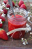Strawberry jam in a jar with lettering