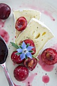 Brie with sour cherries and borage flowers