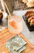White sangria with strawberry peach popsicle garnish