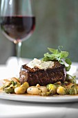 Grilled Certified Angus Beef Tenderloin with Maytag Blue Cheese Butter and Ragout of Brussels Sprouts
