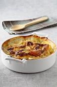 Potato gratin in a round baking dish