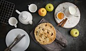 Apple Pie on iron skillet with tea and honey
