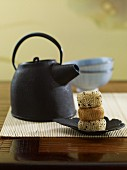 A teapot and sticky rice balls with sesame seeds (Japan)