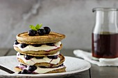 Pancake Stack with Yoghurt, Cream, Blueberries and Maple Syrup