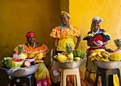 Women wearing traditional costume selling fruit in Cartagena, Colombia, South America