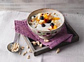 Almond and fruit yoghurt with pine nuts
