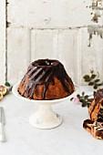 Gugelhupf with a chocolate glaze on a cake stand
