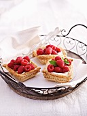 Puff pastry tarts with raspberries