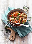 Quinoa and chickpea dish with vegetables served in a pan