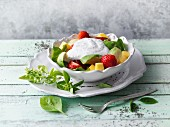 Avocado fruit salad with chia yoghurt and fresh basil