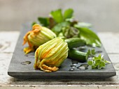 Stuffed courgettes with a herb salad