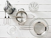 Kitchen utensils: handmixer, pot, whisk, strainer, glass dishes
