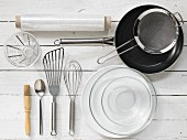 Kitchen utensils: pan, sieve, spatula, whisk, pastry brush, measuring cup