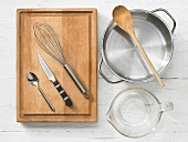 Kitchen utensils: pot, measuring cup, spoon, knife, whisk