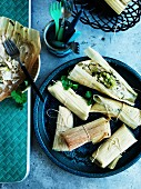 South American chicken Tamales wrapped in corn husks