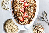 A large oval bowl of Strawberry and Rhubarb Breakfast Oat Crisp