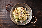 Seafood pasta with clams Spaghetti alle Vongole on wooden background