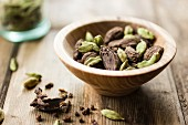 Black and green cardamom seed pods