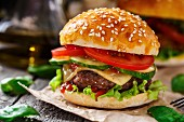 Beef burger with cheese, tomato and cucumber