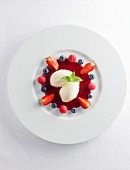 White chocolate mousse with berry sauce