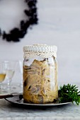 Pickled mustard herring in a glass jar for Christmas