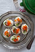 Eggs filled with salmon caviar