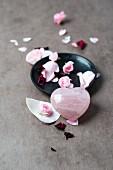 A rose quartz with rose petals