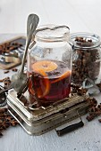 Orange punch with star anise in a preserving jar