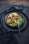 Vegan pasta with soya goulash, chickpeas and baby leaf spinach