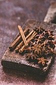 Star anise and cinnamon on a wooden board